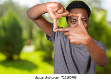 African American male making frame with his hands