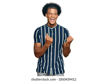 African american man with afro hair wearing casual clothes excited for success with arms raised and eyes closed celebrating victory smiling. winner concept.  - Shutterstock ID 1850439412