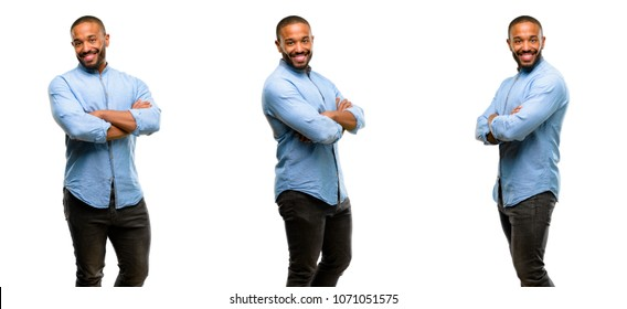 African american man with beard with crossed arms confident and happy with a big natural smile laughing