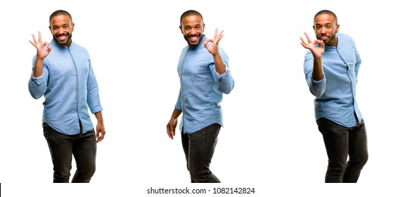 African american man with beard doing ok sign with hand, approve gesture