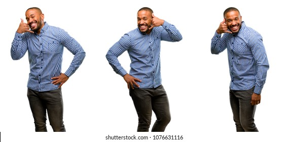 African american man with beard happy and excited making showing call me gesture with hand shaped like telephone