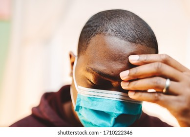 african american man in blue and white surgical  face mask