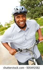 African American man exercising and riding a bike.