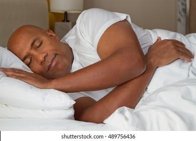 African American man fast asleep.
