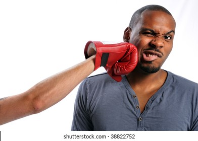 African American man getting hit on face by gloved hand