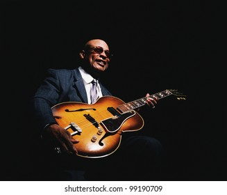 African American man with guitar