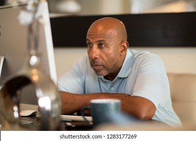 African American man having computer problems.