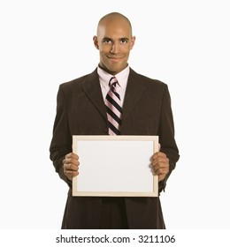 African American man holding blank sign standing against white background.