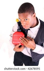 An african american man holding a gas can