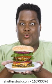African American man holding a hamburger isolated over white background