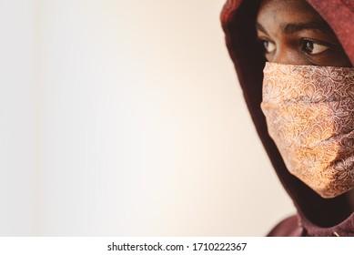 african american man in homemade handmade face mask