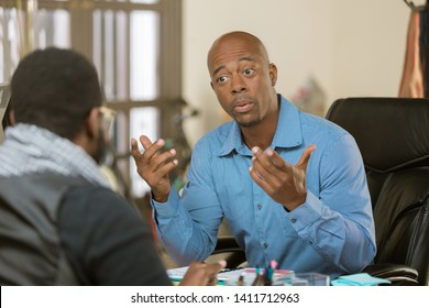 African American man in an office setting with client or coleague