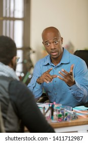 African American man in an office talking with a client or coleague