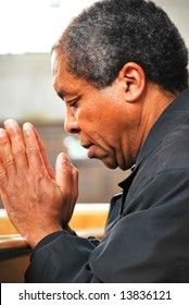 African american man praying in church.