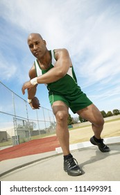 African American man preparing to throw discus