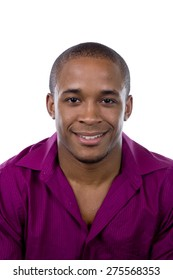 African American man in a purple shirt smiling