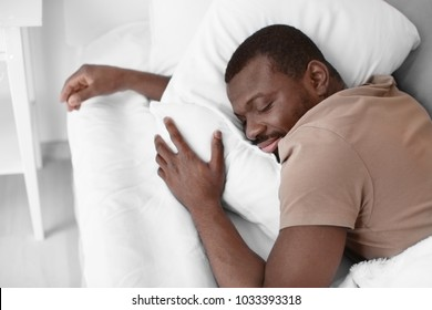 African American man sleeping in bed