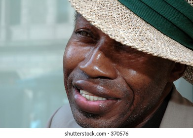 African American man with straw hat, study three