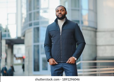African American man in stylish new clothes on the street
