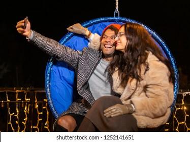 African american man taking selfie at Christmas market, Zagreb, Croatia.