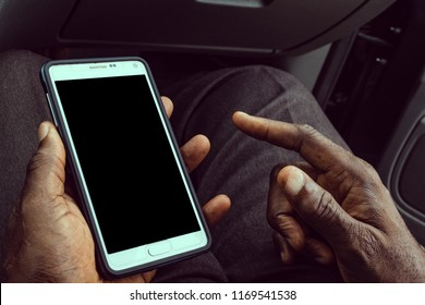 African American man using mobile smart phone with blank black screen. Mock up of a Black man holding device and touching screen. Clipping path