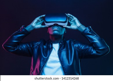 African american man in vr glasses, watching 360 degree video with virtual reality headset isolated on black background