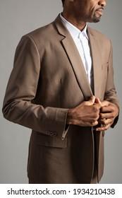 African American man wearing brown suit