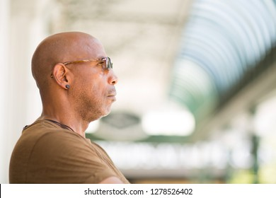African American man wearing sunglasses.