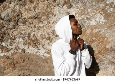 African American man in white hoodie posing outdoor photoshoot