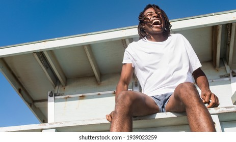 African American man in white tee at the beach