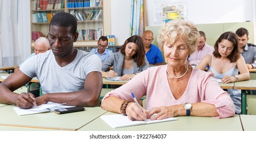 African American man and woman take a written exam in the classroom