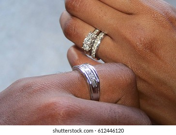 African American Married Couple Showing Off Their Rings