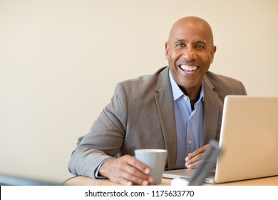 African American mature businessman at work.