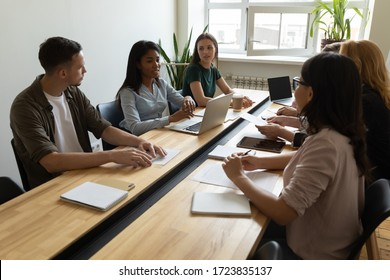 African american mentor businesswoman conducts coaching in boardroom using laptop at company meeting. Confidence black woman training corporate team with computer at briefing.
