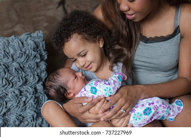 African American mother daughter and baby