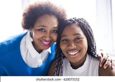 An African American mother and daughter close portrait