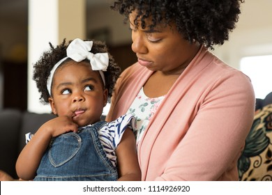 African American mother parenting her young child.