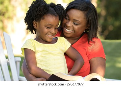 African American mother reading to her daughter