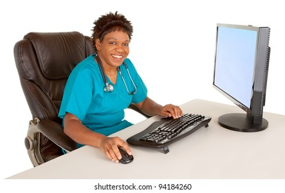 African American Nurse Smiling at Camera While Sitting at her Desk