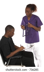 African American nurse with stethoscope having a male African American patient sign release forms