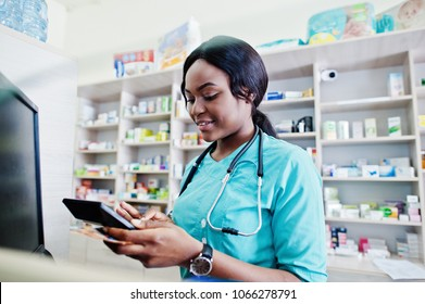 African american pharmacist cashier working in drugstore at hospital pharmacy. African healthcare.