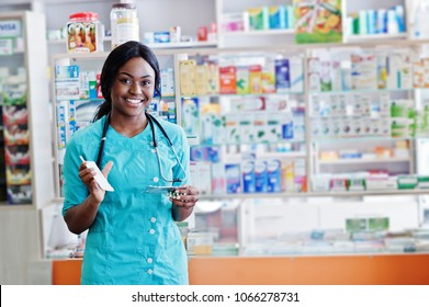 African american pharmacist working in drugstore at hospital pharmacy. African healthcare.