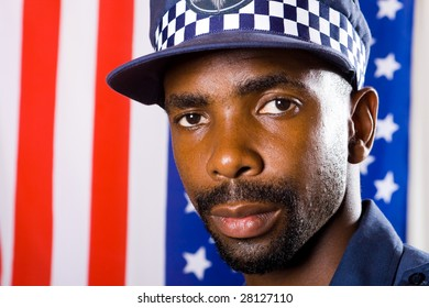 african american policeman portrait, background is USA flag