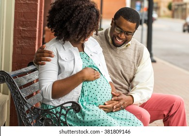 African American Pregnant Woman Outside.