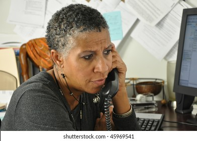 African American Professional Woman Listening on Phone Serious Facial Expression