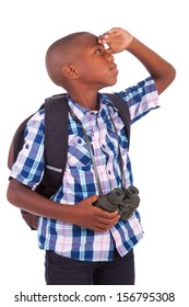 African American school boy holding binoculars, isolated on white background - Black people