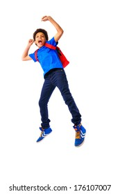 African American school boy, teenager smiling and jumping happy,education and school concept. Isolated, over white background, with copy space. Full body portrait.