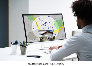 African American Searching Real Estate House On Map