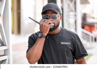 African - American security guard outdoors