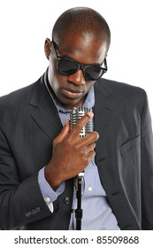 African American Singer holding a vintage microphone isolated on a white background